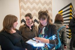 Curators Daisy McMullan and Emma Neuberg with Ele Carpenter (centre)